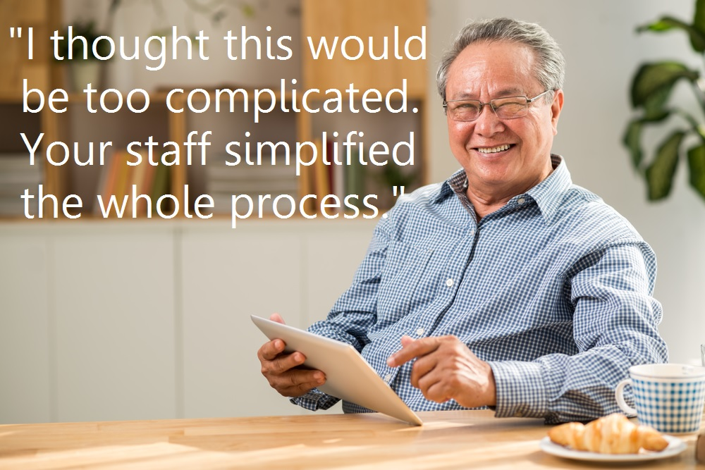 asian man middle age smiling with tablet and coffee with quote shutterstock_411135493